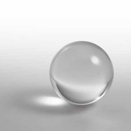a clear crystal ball and light reflections in grey gradient back
