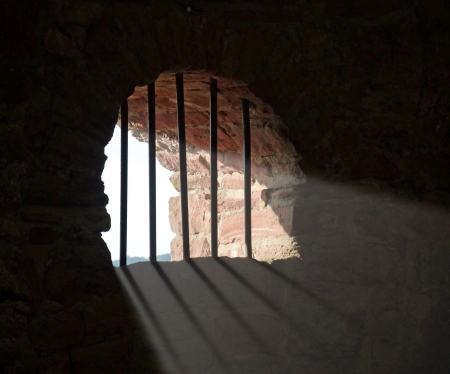 indoor shot of a trellised historic window at Wertheim Castle in Southern Germany while light is falling in