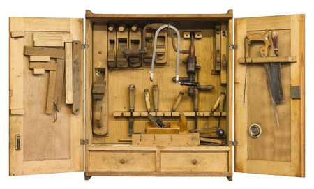 old historic tool cabinet filled woth woodworking tools.Frontal shot with open doors in white back with clipping path