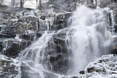 detail of a waterfall near Todtnau, a town in the Black Forest in Germany at winter time