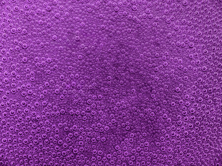 full frame abstract underwater background with lots of small air bubbles in violet ambiance
