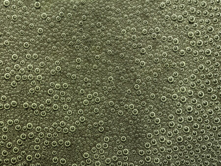 full frame abstract underwater background with lots of small air bubbles