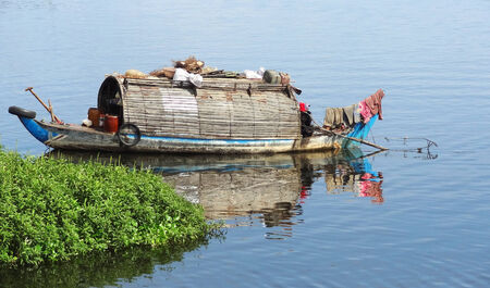 waterside scenery with rural houseboat at the Tonle Sap, a river in Cambodia