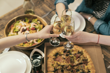Photo pour above view of Asia sisters friends cheer up for successful business or New Year eve. dinner table with champagne. - image libre de droit
