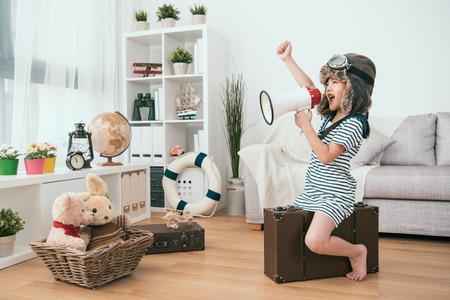 Foto de kid holding a megaphone and raising a hand. she's ready for the next round - Imagen libre de derechos