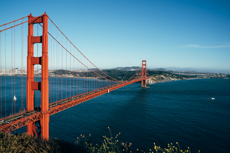 Foto de Golden Gate Bridge San Francisco California USA. beautiful urban city view and clean blue sky sea ocean seeing from nature mountain hills. red iron bridge for cars passing. - Imagen libre de derechos