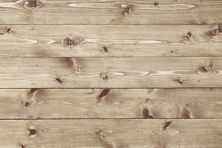 Architectural background texture of a panel of natural unpainted pine board cladding with knots and wood grain in a parallel pattern conceptual of woodwork, carpentry, joinery and constructionの写真素材