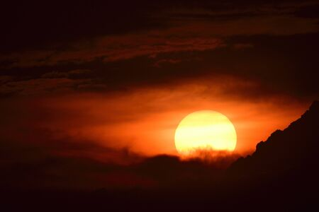 Photo for sunset in evening with dark cloud and  black shades - Royalty Free Image