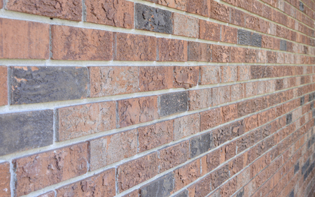 image of a red brick wall fading away from view