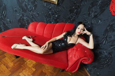 Mistress lying on the couch