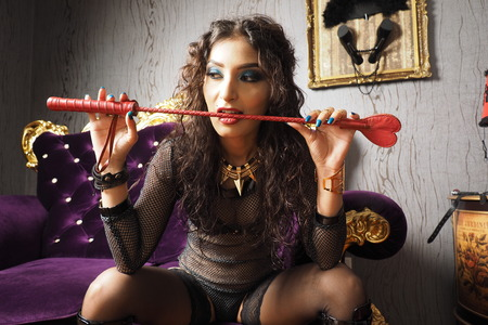 Mistress with whip in the mouth