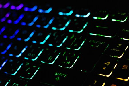 Photo for Colorful modern keyboard with rainbow backlight on black background. Backlight of the keyboard in different colors - Royalty Free Image
