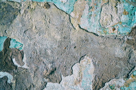 Cement wall with fragments of old paint