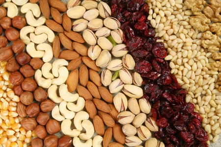 Nuts and corn - hazelnuts, cashews, almonds, pistachios, dried cranberry and walnuts background. Dry food.