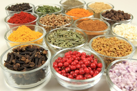 Cuisine ingredients - herbs and spices. Food additives in glass bowls.