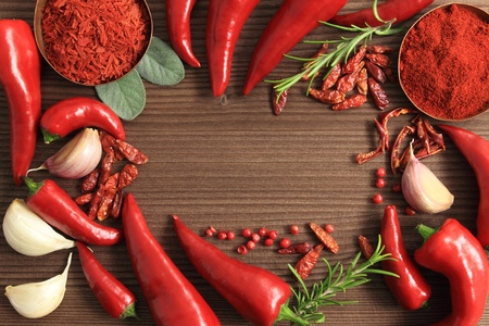 Frame made of red peppers and spices.