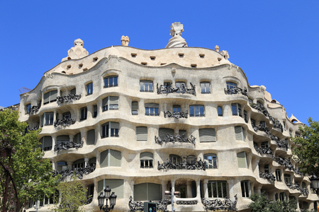 BARCELONA, SPAIN - AUGUST 9, 2015: La Pedrera building in Barcelona. It is also known as Casa Mila, was designed by Antoni Gaudi and has been a UNESCO site since 1984.