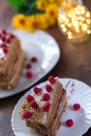 Homemade cake baking on a platter on a wooden background
