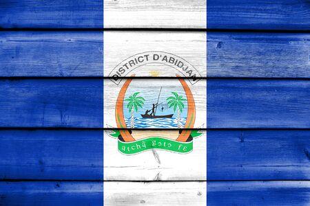 Flag of Abidjan, Ivory Coast, painted on old wood plank background