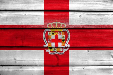 Flag of Almeria, Spain, painted on old wood plank background