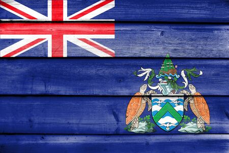 Flag of Ascension Island, Canada, painted on old wood plank background