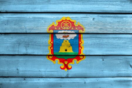 Flag of Ayacucho, Peru, painted on old wood plank background