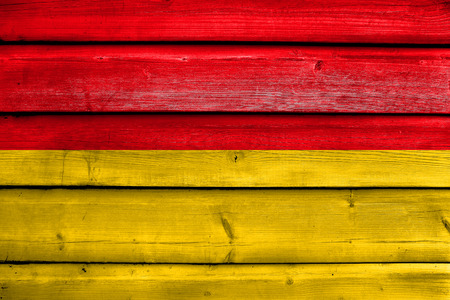 Flag of Cuenca, Ecuador, painted on old wood plank background