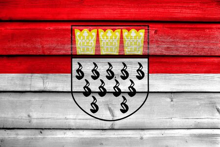 Flag of Cologne, Germany, painted on old wood plank background