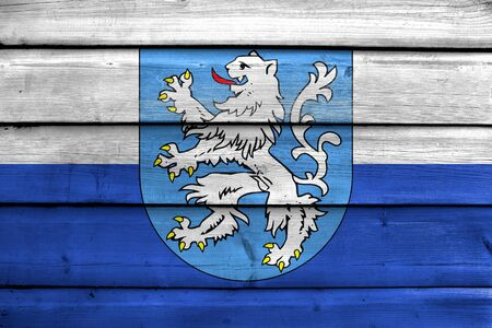 Flag of Mlada Boleslav with Coat of Arms, Czechia, painted on old wood plank background
