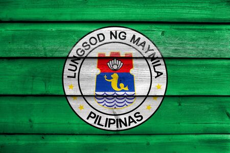 Flag of Manila, Philippines, painted on old wood plank background