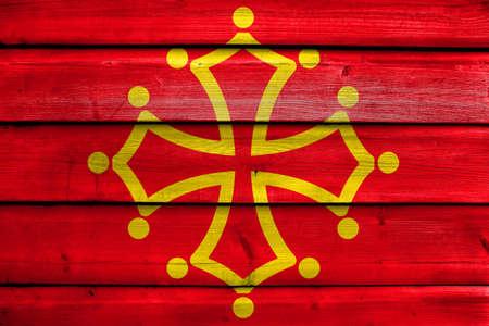 Flag of Midi-Pyrenees Region, France, painted on old wood plank background