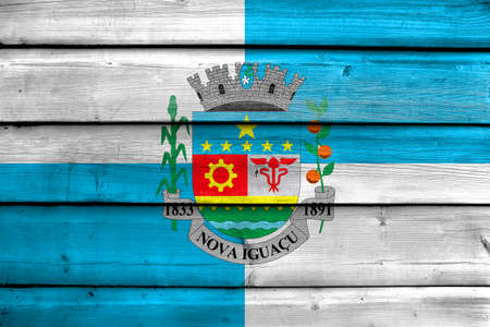 Flag of Nova Iguacu, Brazil, painted on old wood plank background