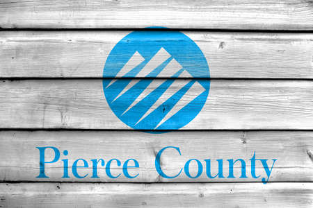 Flag of Pierce County, Washington, USA, painted on old wood plank background