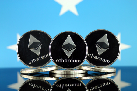 Physical version of Ethereum (ETH) and Micronesia Flag. Conceptual image for investors in cryptocurrency, Blockchain Technology, Smart Contracts, Personal Tokens and Initial Coin Offering.