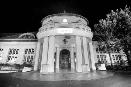POLANICA ZDROJ, POLAND - AUGUST 26, 2019: The spa park in the center of Polanica Zdroj, Lower Silesia, south-western Poland. Spa resort with historical mineral water pump room. Night view.