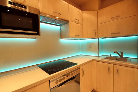 Photo pour Modern luxury kitchen with custom made furnishings and LED RGB backlit glass - image libre de droit
