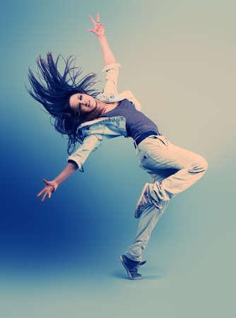 Teenage girl dancing hip-hop at studio.