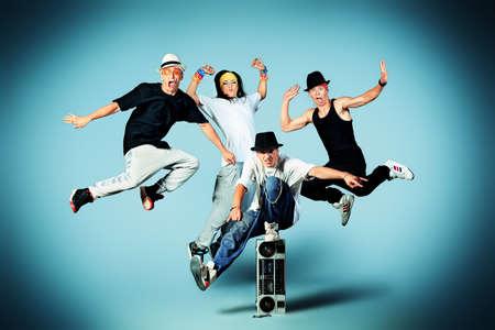 Group of modern dancers dancing hip-hop at studio.