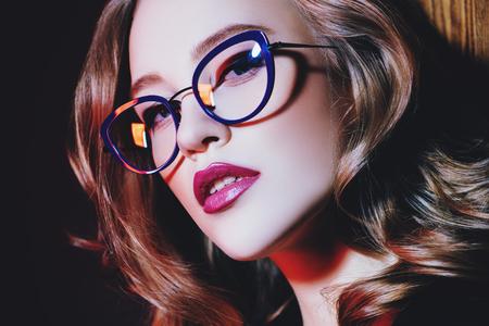 Foto de A close up portrait of a confident lady wearing glasses. Beauty, make-up, style. - Imagen libre de derechos