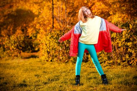 Photo pour A cute fair-haired girl in countryside. Beauty, autumn fashion. - image libre de droit