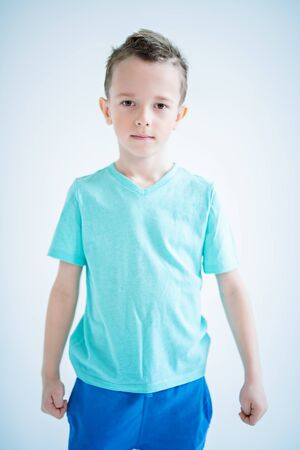 Photo for A portrait of a handsome child boy posing in the studio over the blue background. Kids, fashion, casual style, beauty. - Royalty Free Image