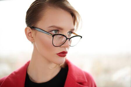Photo pour Business style. Portrait of a fashionable blonde woman in elegant glasses. Optics, eyewear. Copy space. - image libre de droit