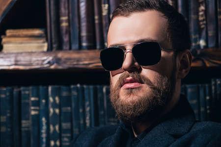 Foto de A close up portrait of a stylish man wearing sunglasses. Beauty and style for men. - Imagen libre de derechos