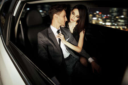 Photo for Glamorous passionate couple in a car. Beauty, fashion. - Royalty Free Image