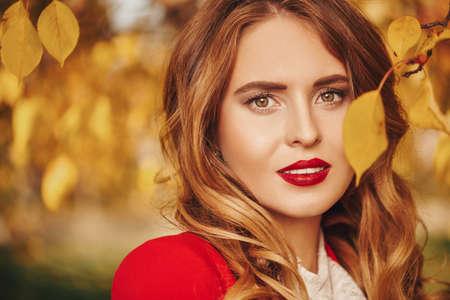 Foto de Beauty portrait. Beautiful young woman over sunny autumn background. - Imagen libre de derechos