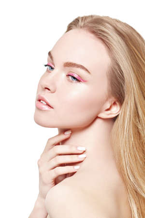 Photo pour Beauty and spa. Portrait of a beautiful blonde girl with light fresh makeup in pink make up on a white background. Skin care. Makeup and cosmetics. - image libre de droit