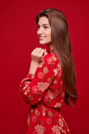 Photo pour Charming happy girl in bright summer dress on a red background. Love and Valentine's Day. - image libre de droit