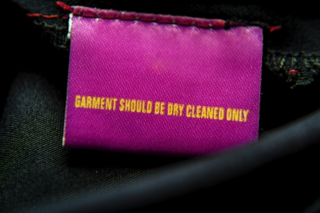 Cloth having specific instructions for dry-cleaning it only  Message on top of the tag