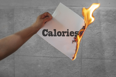 Photo for Burn calories text on paper which is burning - Royalty Free Image