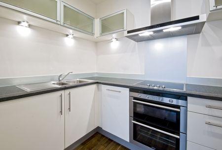 modern white kitchen with grey stone work top